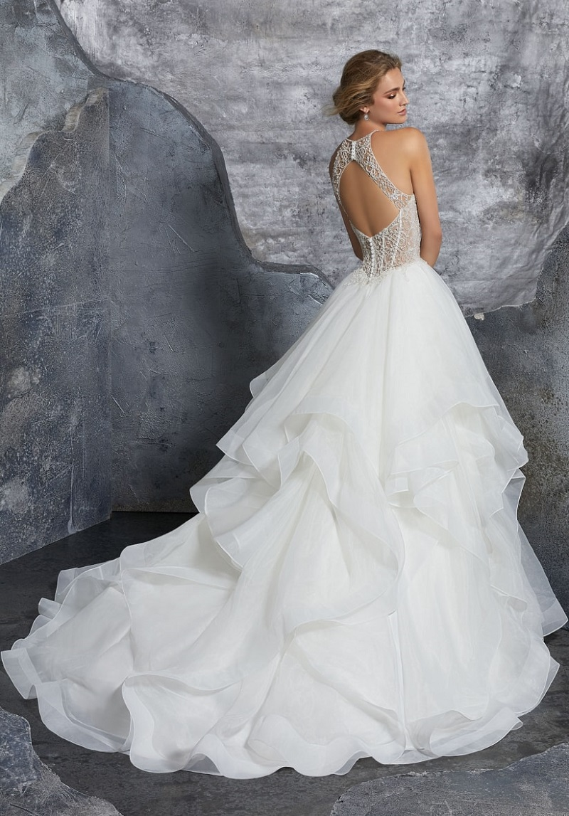 The 10 sexiest wedding dresses of 2019: halter neckline and open back for an ultra sensual look